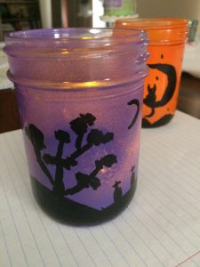Purple lantern with a tree & graveyard scene
