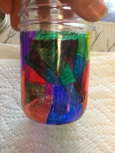 Here's my mason jar, mostly finished, I decided to add black lines along the edges of my shapes for fun.