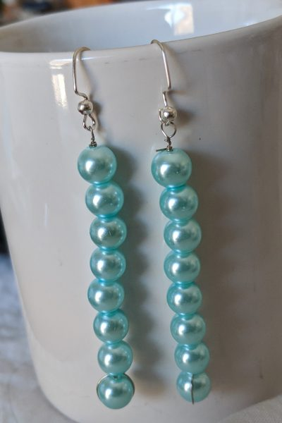 "Sometimes all you need is a nice long ""tassel"" of pearls hanging off your ears!"