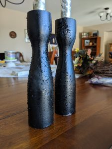 All you need for candlestick holders are some cheap wooden ones, some black spray paint and maybe some glitter!
