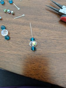 Start with a combo of three beads on the bottom of your headpin