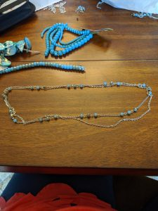 Begin with a turquoise beaded chain and a plain silver chain