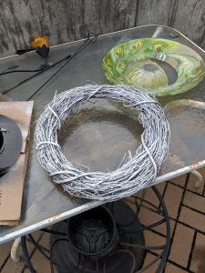 You just need a thin coat of white spray paint on your grapevine wreath, don't go crazy!
