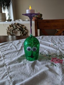 Just use a hot glue gun to attach some googly eyes and a paint marker to draw a bit of a face on