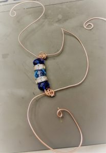 For an added bit of polish, a group of beads add some sparkle to your wire wrapping wave