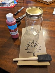 To complete this craft, you just need a mason jar, craft paint, brush and a stencil!