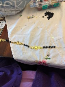 First you need to attach the bats together with a set of black beads