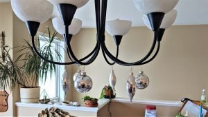Christmas ornament balls aren't just for trees, try hanging them on your light fixtures!