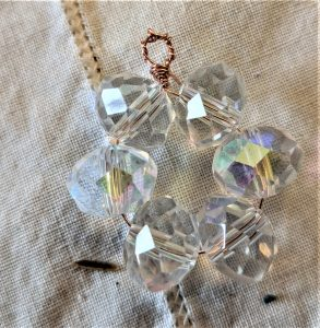 For this project, you start with the thinner wire to string your beads into a circle