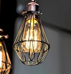 "Your light fixtures should be ""rustic"", look for metals and woods!"