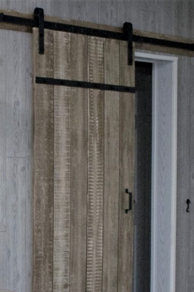 a barn door can add a unique style to an interior room!