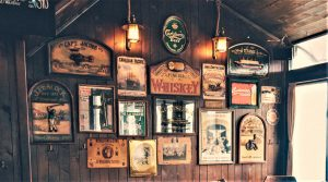 a gallery of rustic signs can really dress up a blank wall in your home!