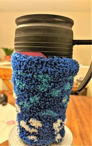 One of the easiest and unique ways to upcycle old orphaned socks is to make a coffee coozie out of them!