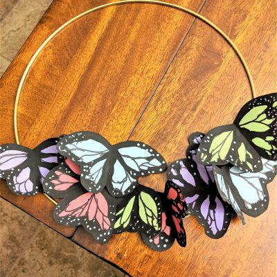 Once you've made your pretty paper butterflies, you simply glue them onto your wreath!