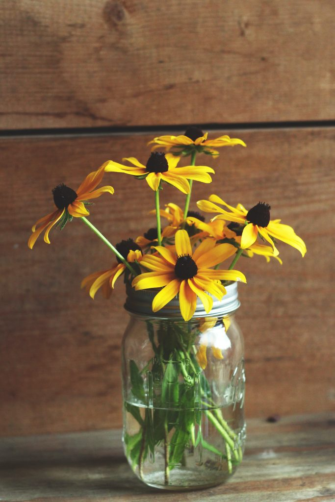 Mason jars are perfect vases, if you dislike the plain glass look there are a number of ways to dress them up!
