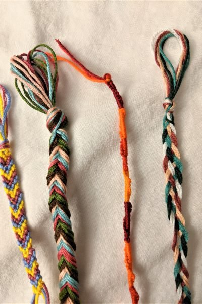 Here are four of my seven favorite friendship bracelets, all ready to wear!