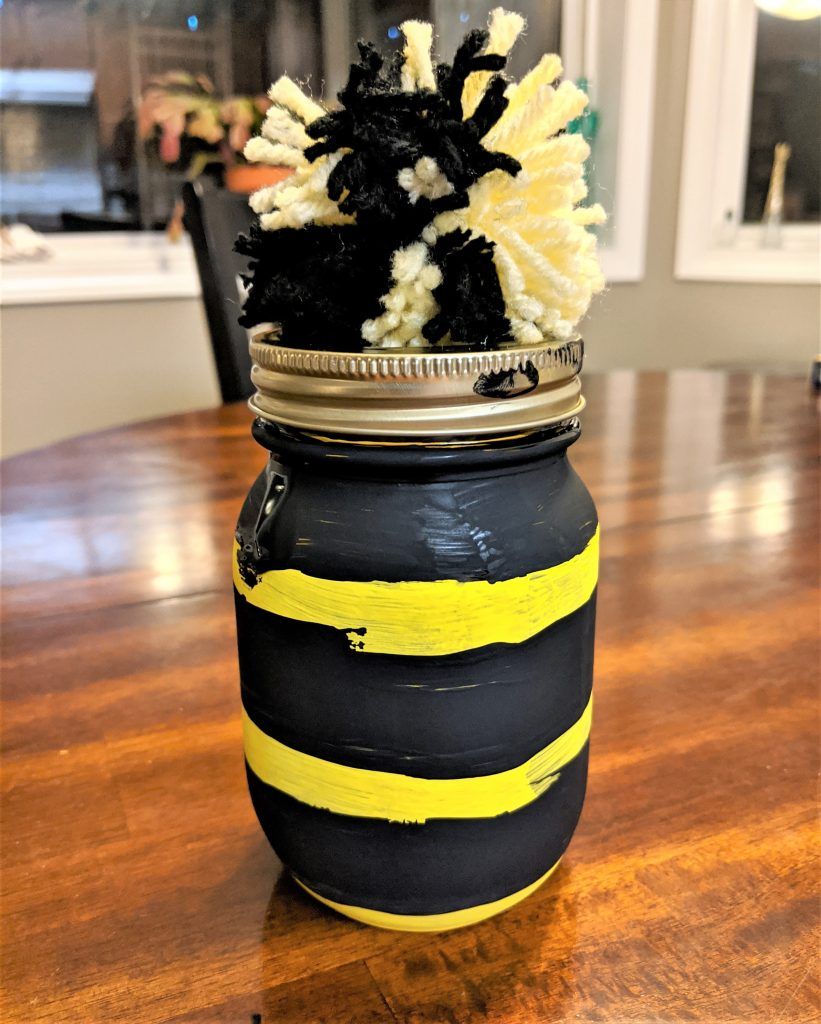 Mason jars are a snap to throw together with some craft paint. You just need to paint stripes on.