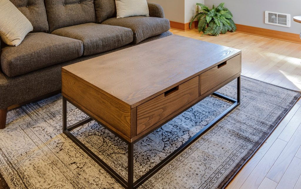 Coffee tables with a wood and metal look like this one are right in the industrial decor style!