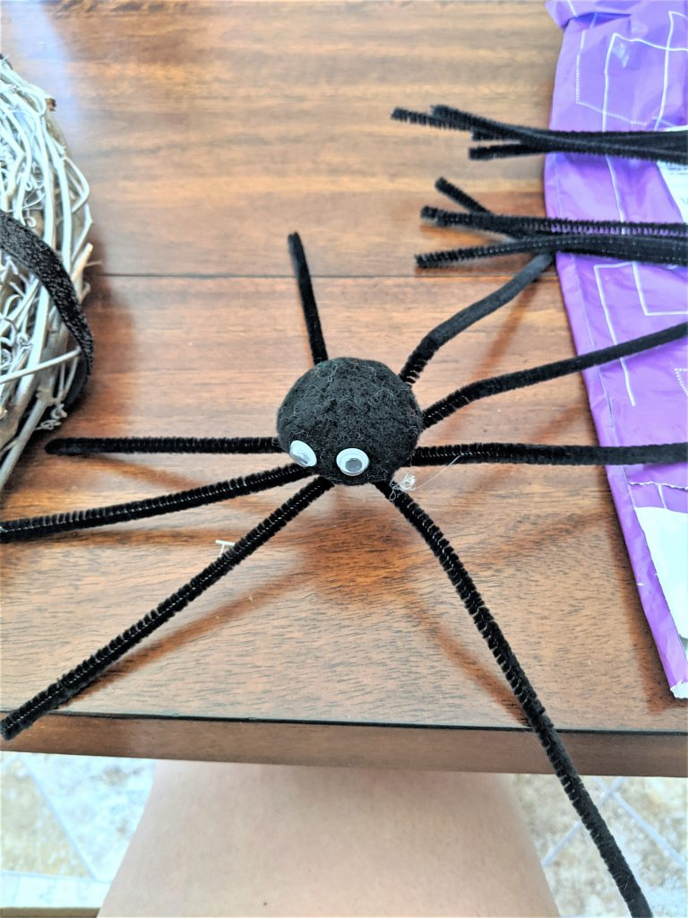 Once the glue is dry, gently spread apart the legs to give it the official spider look!