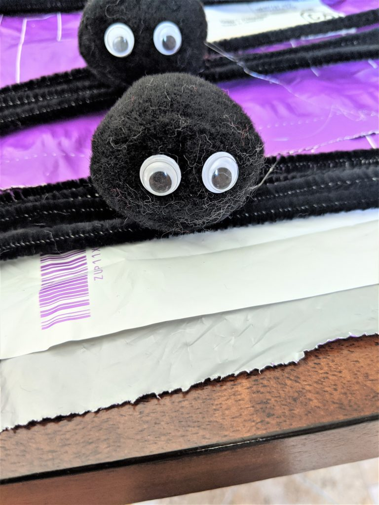 Once you've glued the body to the legs, you can add some fun googly eyes!
