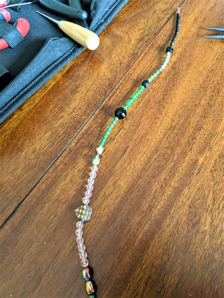 As you string along your beads, you'll see a lovely necklace starts to take shape!