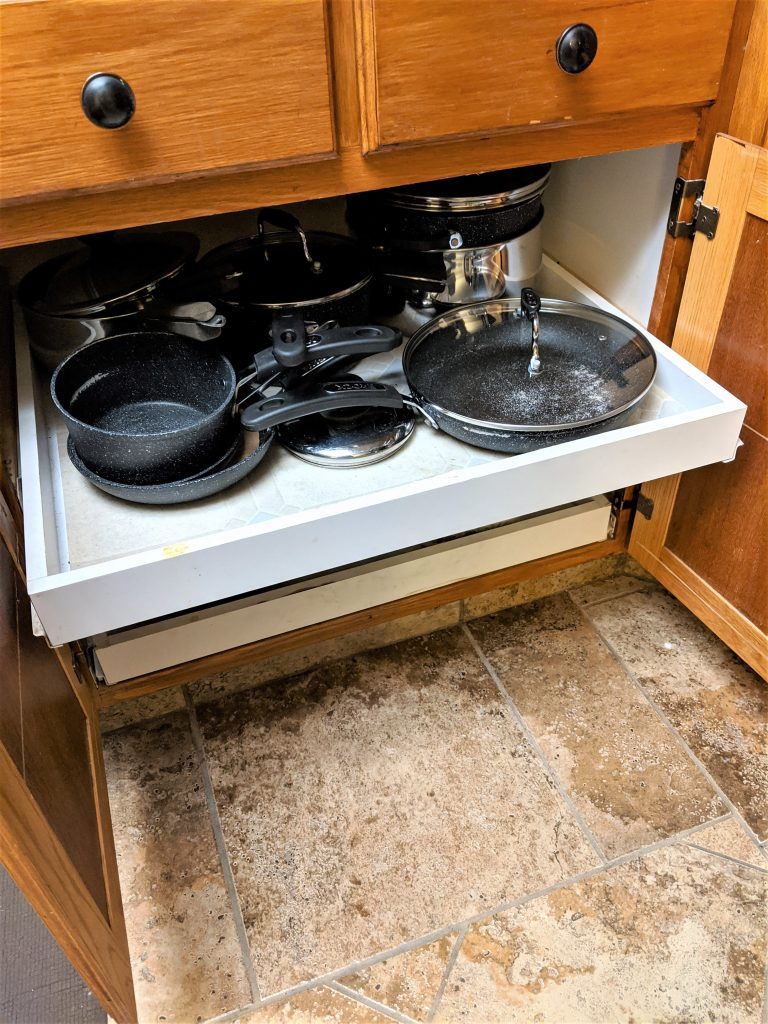 I use my pull out drawers for pots, but you can also try small appliances or plates in them!