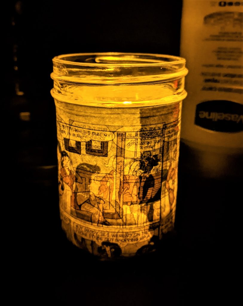 Once your mod podge cures (read the package for details), simply insert your candle or votive and enjoy your new mason jar candle!