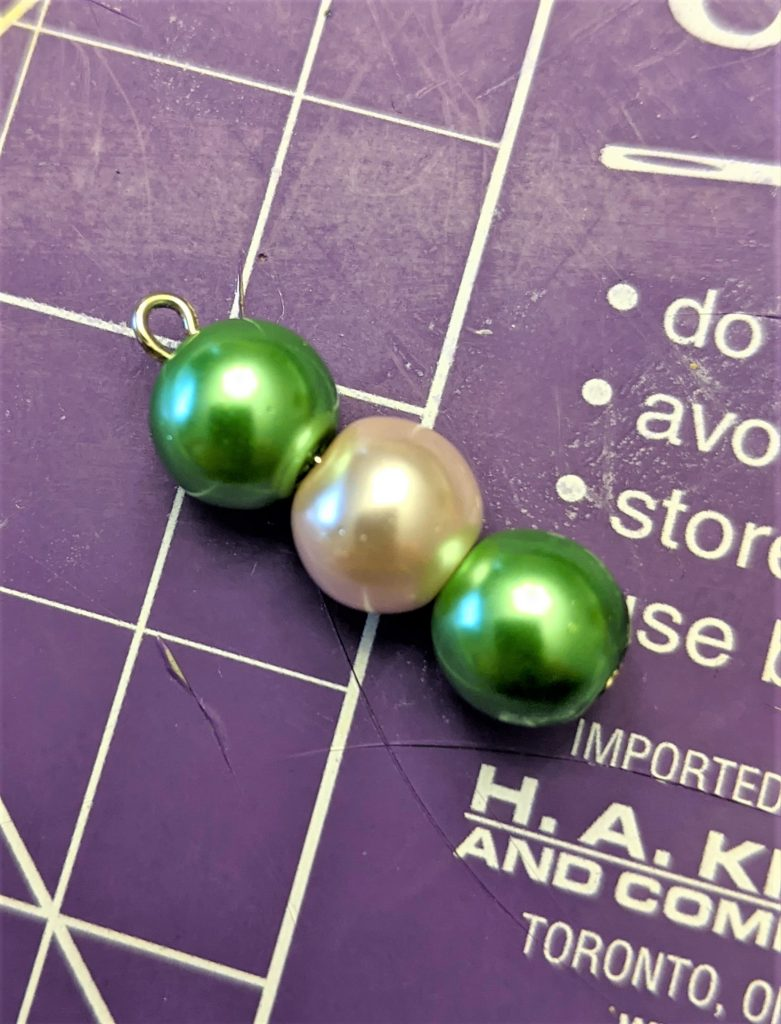 Some simple pearls can instantly class up a necklace!