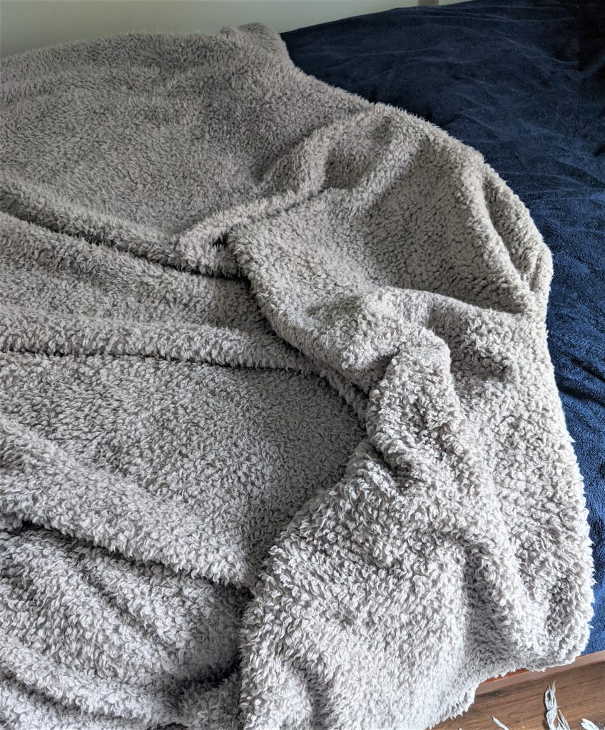 A soft sherpa blanket like mine can add a very cozy layer to your bedroom space!