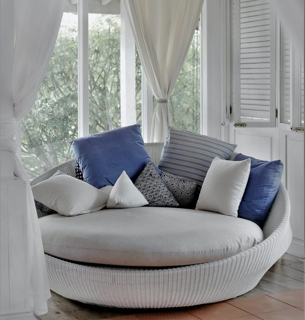 A lovely inviting reading nook can make a large bedroom function much better!